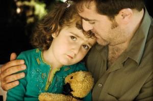 mapi-comforting-child
